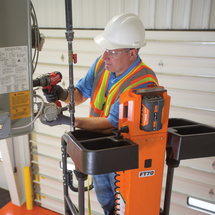Operator completing work at height with JLG® LiftPod