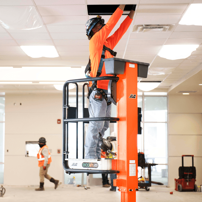 Operator accessing ductwork with JLG® EcoLift